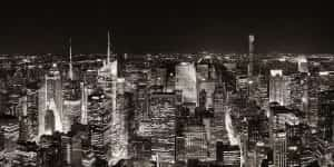a black and white photo of the New York City skyline at night