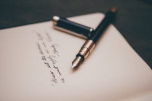 a photo of a fountain pen and a handwritten note