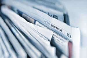 closeup of newspapers showing the business section